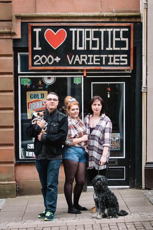 Urban family group outside sandwich shop in Midsteeple, Dumfries