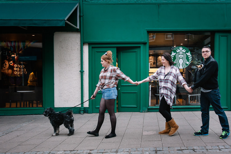 Family walking dogs outside Dumfries Starbucks shop