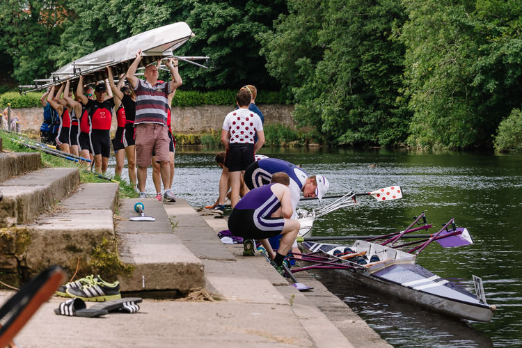 The regatta runs smoothly as one crew after another taking their turn at the dock