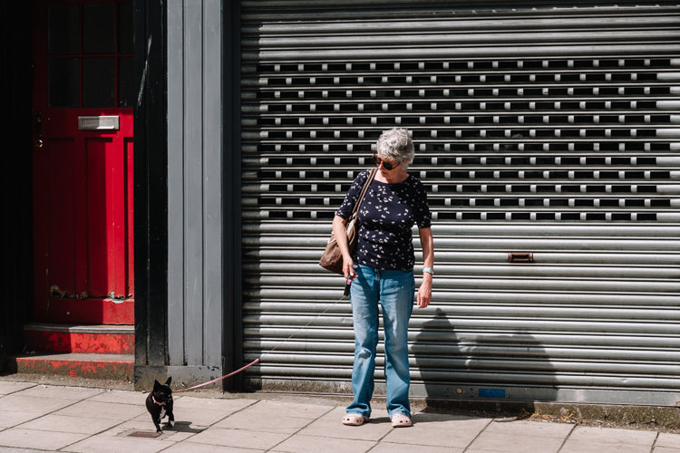 Dumfries street photographs – a woman with her pug