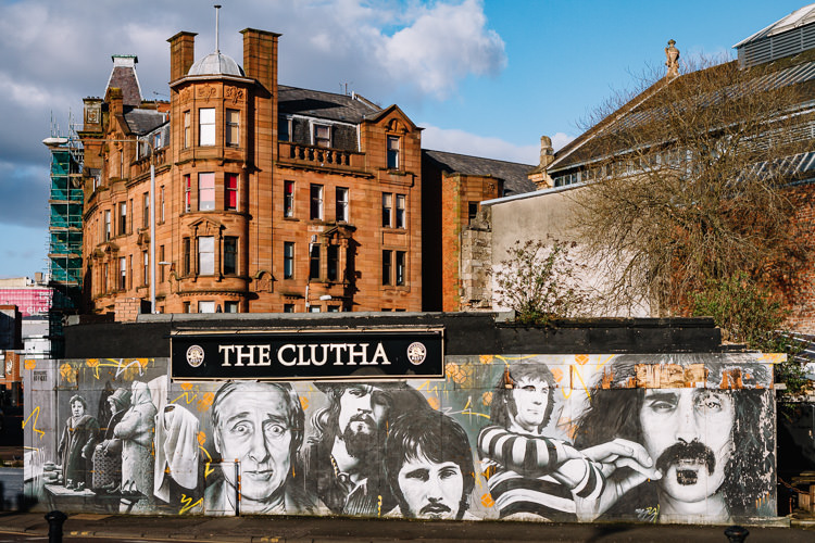 Glasgow Clutha Bar mural bathing in the afternoon sun