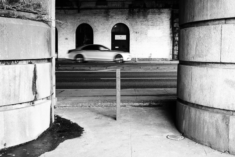 Moving car passing under Caledonian Bridge