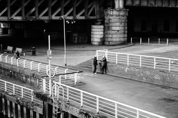 Two men in conversation on Clydeside walk