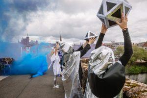 Mystic performance by Maddjakallss with lavender smoke on Devorgilla Bridge