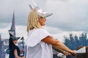 Blou Rain wearing a white jackal mask for Nithraid 2018