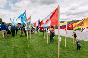 A circle of flags in Nithraid Village to celebrate Amaze Me Leader project participants