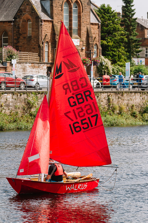 Sailing boat race entrant passing Nithraid Village