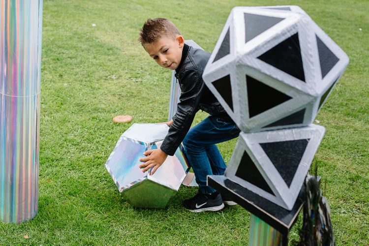 Boy building with magic shapes