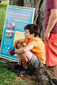 Boy near Rosefiled Mill board, celebrating the much loved landmark planned revival
