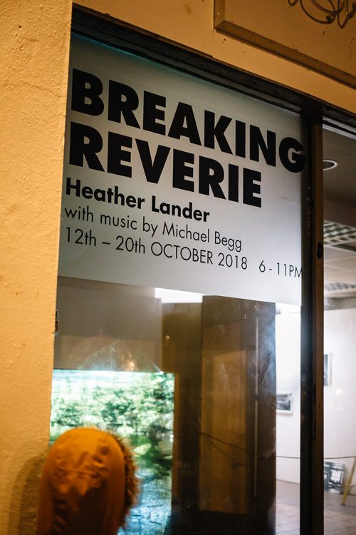 Young Doonhamer glued to the window watching Breaking Reverie under the artwork banner