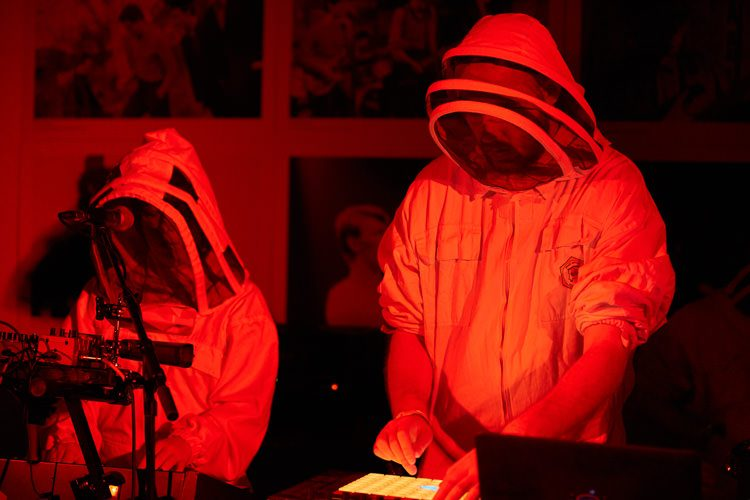 Members of Future Get Down band perform live in beekeeper suits for Dumfries Music Conference