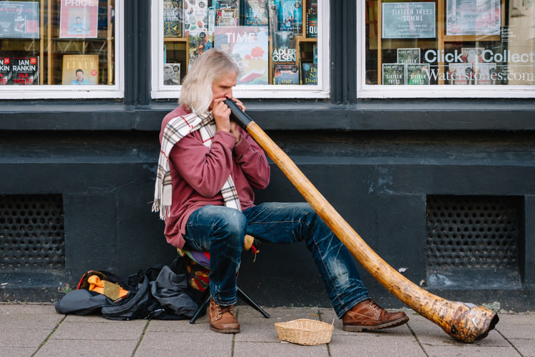 Didgeridoo busker on the streets of Dumfries - urban photography