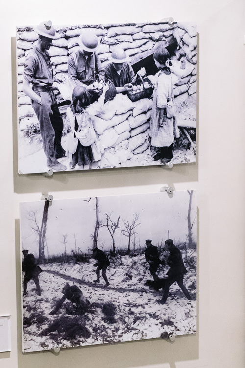 Photos of the humane side of war life - girls trading onions with soldiers for chewing gum and soldiers playing snowball