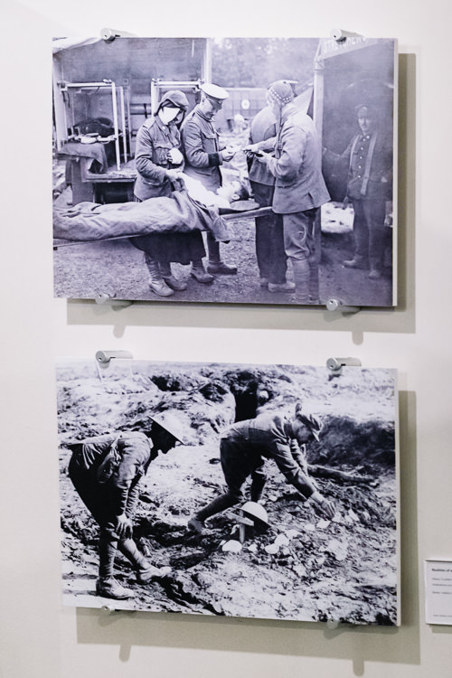 Photos of the harsh realities of war - saying farewell to a wounded comrade and tending to the grave