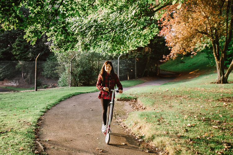 Autumn portraits - a girl on a scooter in Castledykes Park, Dumfries