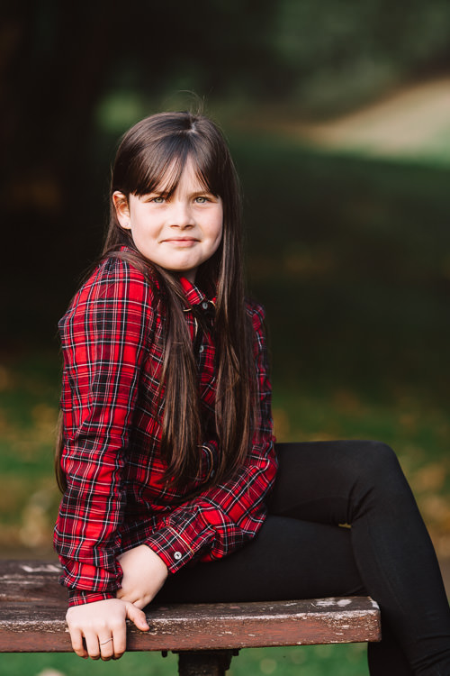 Portrait of a girl in a red tartan shirt