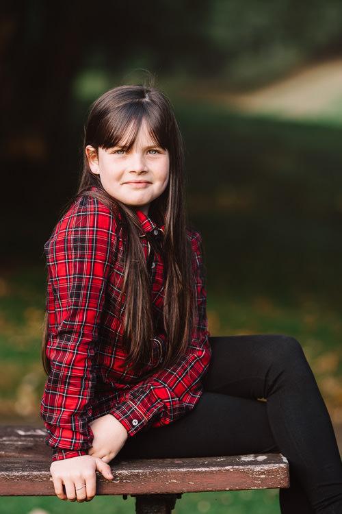 Portrait of a girl in a red tartan shirt