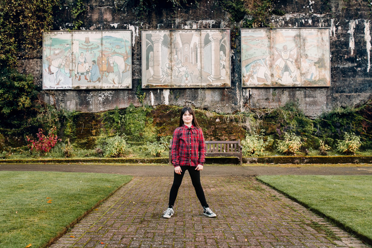 Castledykes Park walled garden portrait in front of John McKay murals depicting the site's historical significance