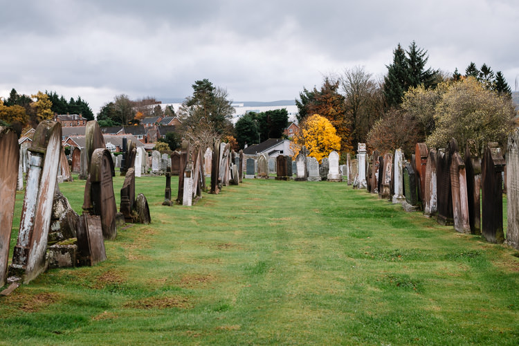 View of the rows of graves at Dumfries High Cemetery