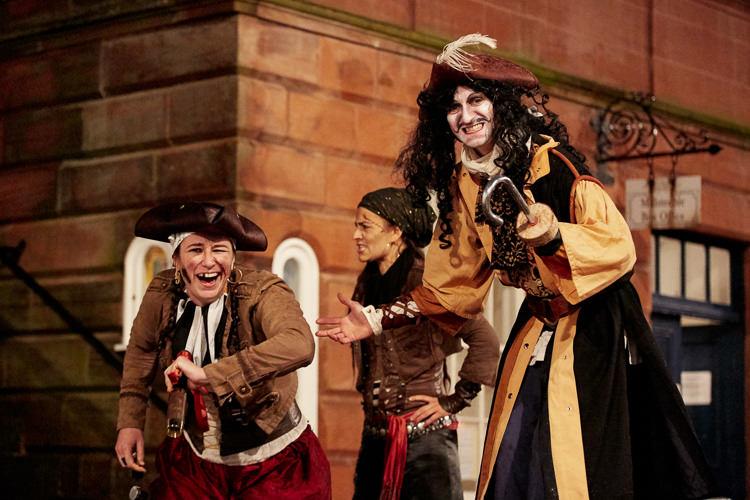 captain Hook and his pirates on the streets of Dumfries for Peter Pan Xmas Lights Switch On