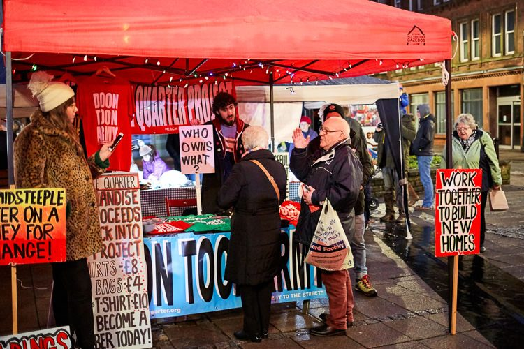 MSQ activists sharing information with the market visitors