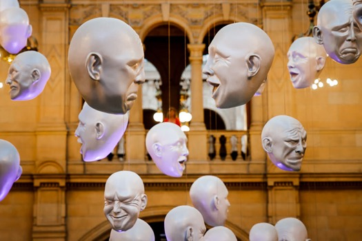 Disembodied head sculptures in a silent conversation at Kelvingrove Museum
