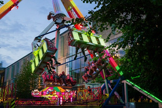 St Enoch Square funfair rides at dusk
