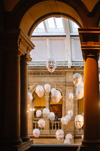 Floating Heads detail framed by the first floor arches and pillars