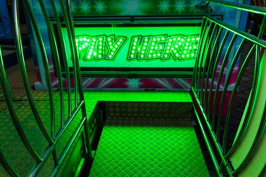 Glowing Viva Mexico ride payment desk ramp