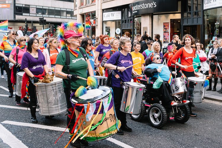 Percussion band beating the tune at Glasgow Pride Parade