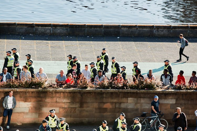 Police hurrying along the river Clyde promenade to reach streets ahead of the Irish republican march