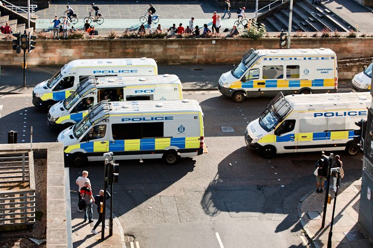 Some of a much larger fleet of police vans