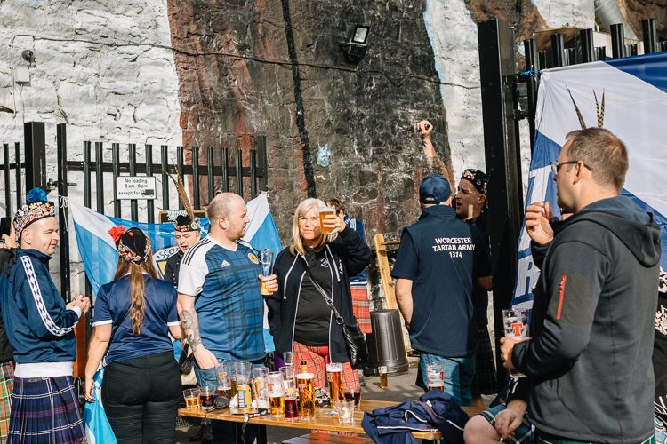 Tartan Army members cheering outside the Hootenanny bar