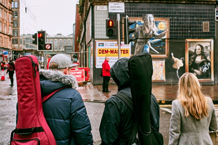 People waiting for at traffic lights on the corner of Argyle and York Street with the Gallery street art piece ahead