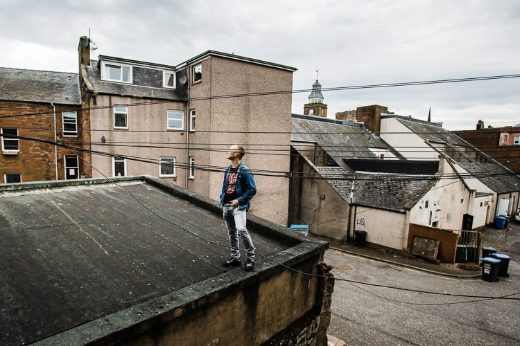 Justin on the rooftop for Urban Portraits Dumfries project
