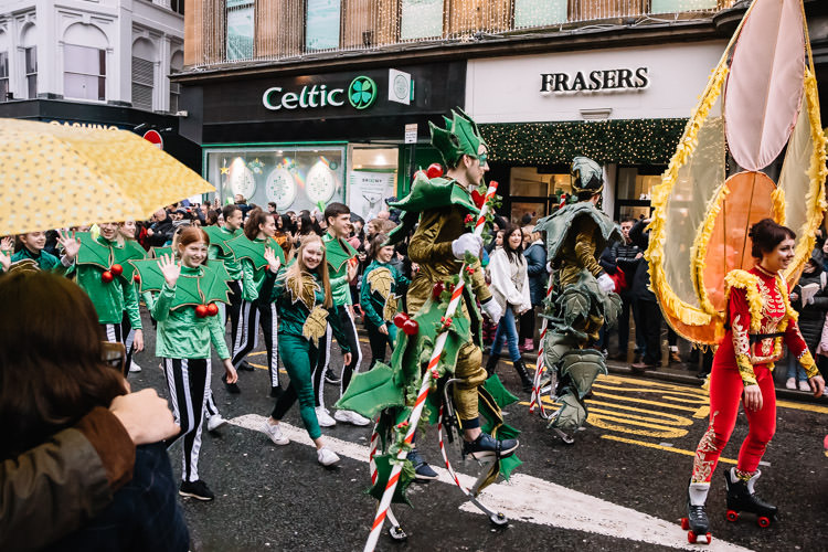 Holly characters on stilts leads the nearly designed Holly section produced by Bridgeman Arts for this year's Glasgown Style Mile costumed procession