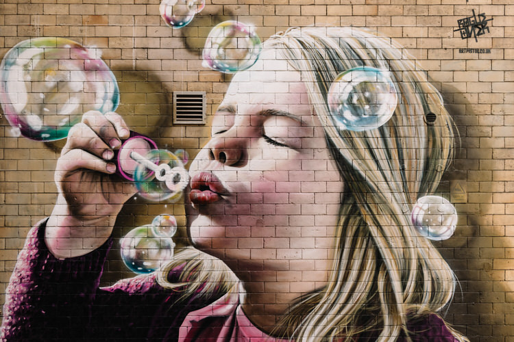 Girl on the right blowing bubbles