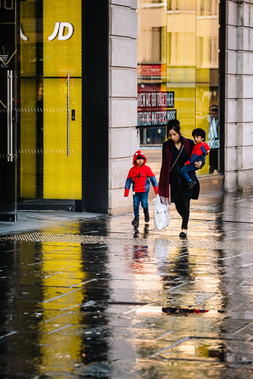 Mum with two Spiderman on Glasgow streets