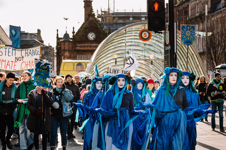 Blue Rebel Brigade performers lead the Blue Wave up Buchanan Street