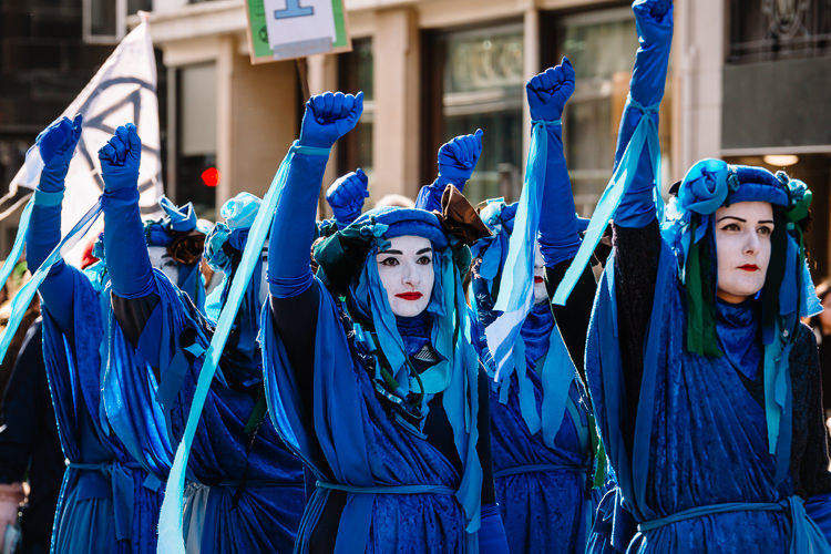 The Blue Rebel Brigade mime the protest