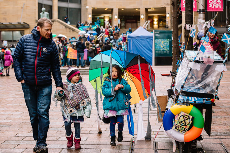 Family leaving the eco demonstration on Buchanan Street