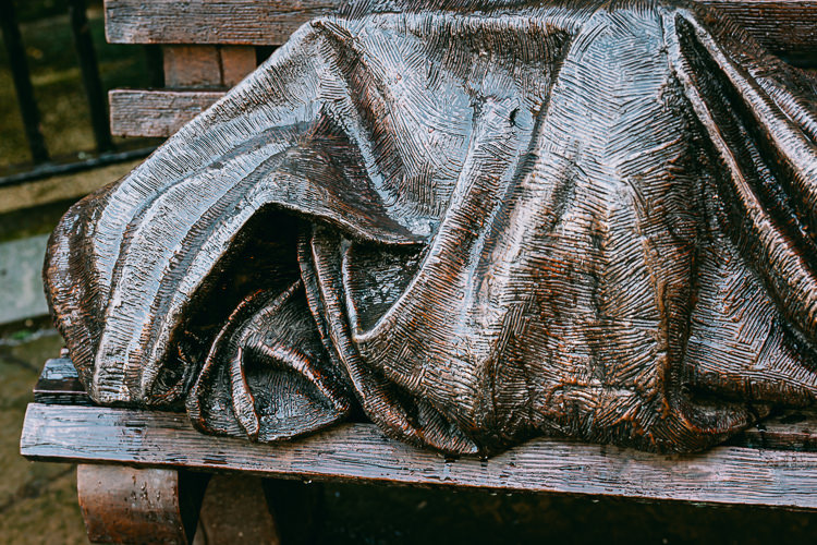 Shrouded anonymous face of the bronze Homeless Jesus figure