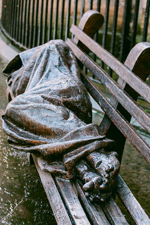 Glasgow cast from the original 2012 bronze sculpture by Canadian sculptor Timothy Schmalz depicting Jesus as a homeless person sleeping on a bench