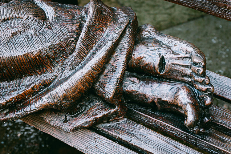Stigmata on the feet of the bronze sculpture