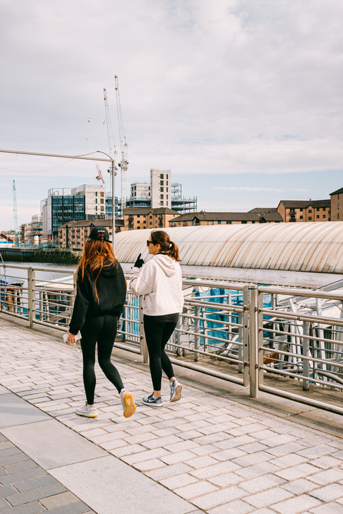 Girls walking past the Ferry restaurant on the Clyde waterfront