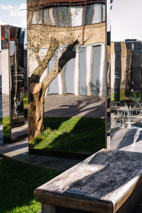 Seating area, and a reflection of the 200-year old olive tree gifted by the people of Tuscany