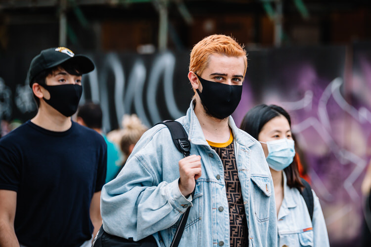 Young people wearing protective masked in public during the coronavirus lockdown
