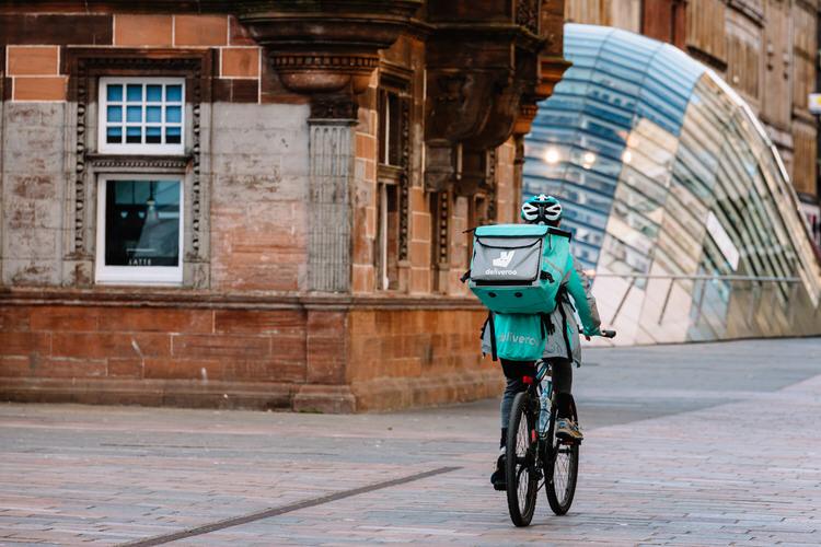 Deliveroo cyclist traversing St Enoch