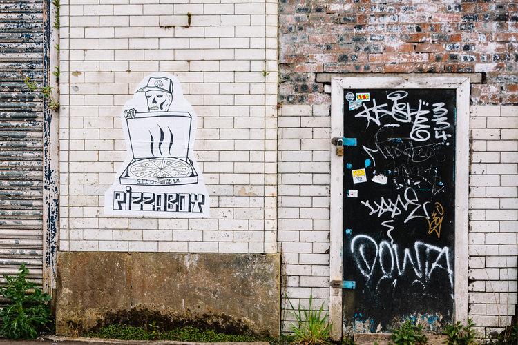 Pizza Boy's paste up street art, Bridgegate, Glasgow
