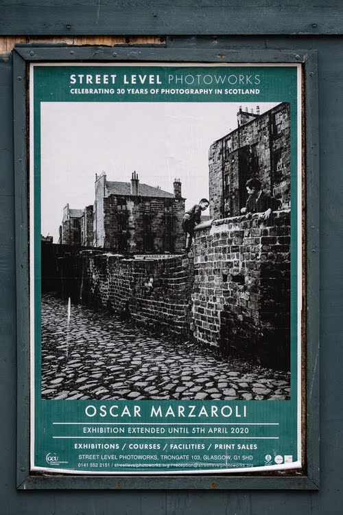 Exhibition poster featuring Marzaroli's black and white photos of boys climbing the black alley wall